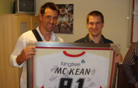 Paul Sculthorpe presents me with a personalised autographed Saint shirt